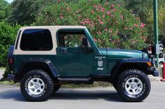 """1999 Green Jeep Wrangler Sport - 3"""" Suspension Lift w/33"""" M/T Tires for $12,995. Click for Details."""