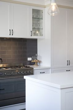Perfect for entertaining, this country-style kitchen renovation in Mooroolbark features clever storage ideas and layers of white to brighten the space. Kitchen Doors, White Kitchen Cabinets, Painting Kitchen Cabinets, Kitchen Paint, Kitchen Design, Kitchen Ideas, Dulux White Paint, White Paints, Country Kitchen Renovation