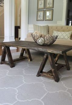 """Sawhorse Coffee Table - As always, we love shopping around for furniture ideas. When we came across this sawhorse coffee table my first thought was """"that's an e Creative Rustic Furniture Plans To Complete A New Home Classic Furniture, Unique Furniture, Rustic Furniture, Furniture Decor, Living Room Furniture, Painted Furniture, Furniture Plans, Kitchen Furniture, Furniture Cleaning"""