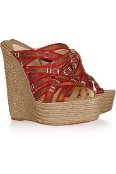 Raffia wedge heel measures approximately 140mm/ 5.5 inches Red, brown and silver canvas Open back, woven buckle trompe l'oeil straps across front, round open toe, signature red leather sole Slip on