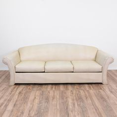 This sleeper sofa is upholstered in a durable off white vinyl. This sofa bed is in great condition with an arched back, curved arms and pull out mattress. Perfect for a guest room! #contemporary #sofas #sofabed #sandiegovintage #vintagefurniture