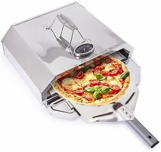 It also arrives fully assembled so it's ready to use straight from the box. It's so simple and you can have freshly made pizza cooked to perfection in minutes! Features a pizza stone for authentic style pizza. Portable Pizza Oven, Portable Bbq, Pizza Oven Outdoor, Barbecue Grill, Grilling, Large Bbq, Stainless Steel Bbq, Pizza Boxes, Bbq Cover