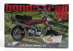 Honda Trail 70 Motorcycle model kit   Made in 1/8 scale by MPC   Seat flips up to expose battery and gas tank   Chrome handle bars   72cc engine   Brand new in