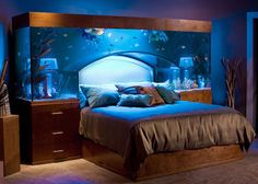 Sleep with the Fishes in Custom-made Aquarium Bed by Acrylic Tank Manufacuring.    (I will not be relax sleeping under a fish tank. As beautiful as it may be, I will always dream of the tank would one day burst while you are sleeping :D