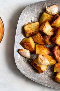 Oven-Fried Patatas Bravas (Crispy Potatoes With Two Sauces) Recipe - NYT Cooking Most Popular Recipes, Favorite Recipes, Side Dish Recipes, Side Dishes, Tapas, Brave, Spinach Pasta, Squash Pasta, Spaghetti Squash