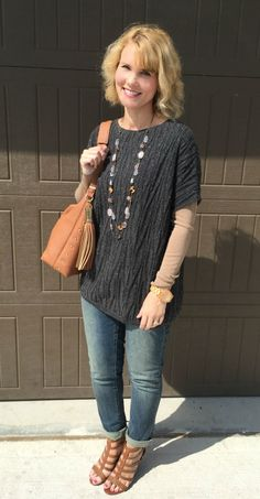 @jbonner pairs her Pure Jill boat-neck poncho with boyfriend jeans and wedges.