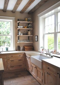 French country kitchen, farm sink, white-washed cypress cabinets, brick/terra-cotta floor, open shelves, exposed beams, limestone counters...