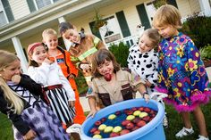 Kids Playing Apple Bobbing Game on Halloween