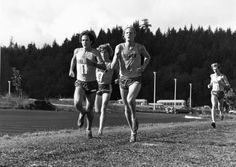 Black and white photo of University of Oregon cross country runners (from l-r) Art Boileau (1), Jeff Nelson (8), and Greg Erwin (4) trailed by a fourth Duck, Bruce Nelson, at the 1979 Northern Division Championships held at Lane Community College. Boileau finished in 11th place, Erwin 9th, and Nelson 7th. ©University of Oregon Libraries - Special Collections and University Archives