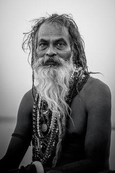 Sadhu Meditating over River Ganges - at the Ghats of Varanasi, Uttar Pradesh, India.© 2013 www.