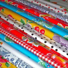 Oilcloth Addict - Blog with great ideas, tips and tutorials for sewing w/laminated cotton, oilcloth and chalk cloth (note the concerns on using oilcloth for any children's projects).