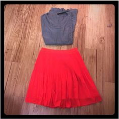 Sexy Sugarlips Red flowy skirt Sexy flowy skirt with underlining and chiffon overlay. Super cute with a sweater for fall winter and boots! Sugarlips skirt by nasty gal, mind condition, like new! Nasty Gal Skirts Mini