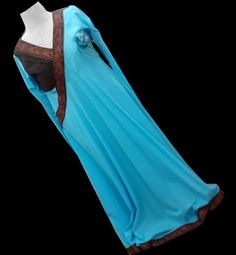 US$ 95  - A voluminous light blue lawn dress which is cut on bias. The shirt has a yoke which is densely pleated on one side with chocolate brown lawn. The neckline is decorated with chocolate brown lace, as well as the daaman and churidaar sleeves. The dupatta is of pure chiffon dyed in brown and blue stripes, with a laced churidaar pyjama, made in chocolate brown lawn. Just to add a little accessory, a blue glittering flower is added.