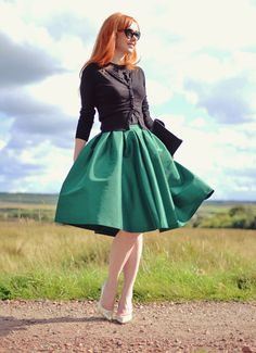 green full skirt and gold heels