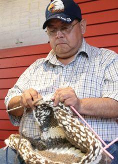 Coast Salish knitter John George, or Tsulhwuletse in Hul'qumi'num, knitting a Cowichan sweater.