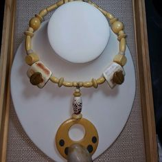 Tan color riverstone choker with cowrie shells Tan color riverstone choker with cowrie shells on memory wire Jewelry Necklaces