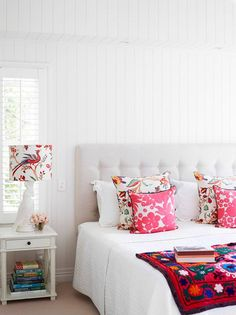 great colors in this mostly white bedroom with pops of color