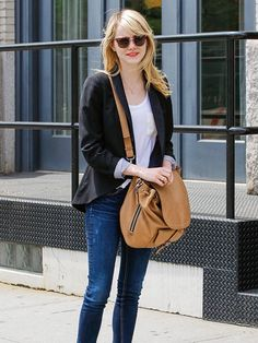 flared out black blazer over half tucked white tee and scuffed up skinnies, cateye-ozzy osbourne sunnies, coral lip and oversized tan crossbody satchel