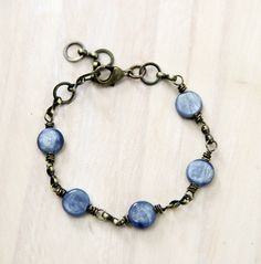 A kyanite stone to represent each of the five deep breaths. Kyanite invites you to speak your truth.