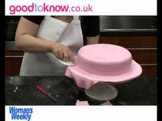 Sue McMahon, cookery editor at Woman's Weekly magazine show you how. See recipe http://www.goodtoknow.co.uk/recipes/450581/Covering-a-cake-with-sugarpaste