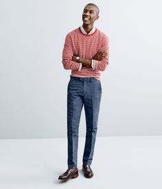 J.Crew   A crewneck sweater over a white OCBD paired with some slim cotton-linen pants.