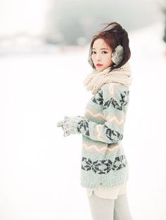 Ulzzang looking very Nordic in a sky-blue sweater, matching ear-muffs and a knit scarf.