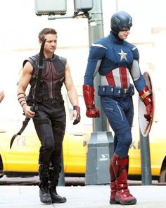 Cap and Hawkeye... Haha they're both in the same pose, wearing funny boots.