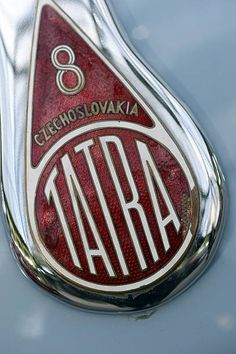 Photo taken on February 6 2013 shows the Tatra logo on a 1948 Tatra berline on display at the Grand Palais in Paris on the eve of an auction of. Car Badges, Car Logos, Car Hood Ornaments, Old Vintage Cars, Badge Logo, Picture Logo, Car Brands, Motorbikes, Automobile