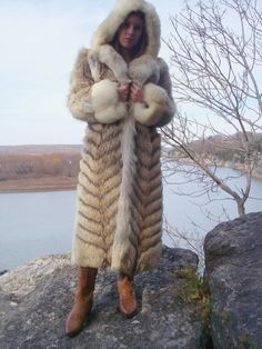 Long Hooded Coyote Fur Coat.