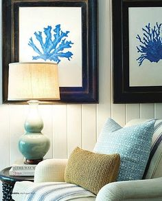 Love this. - love the striped chair, golden pillow, the blues, & dark side table & dark picture frames