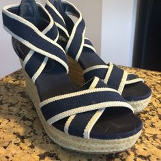 NWOT navy and cream espadrilles Baby and cream stretch material criss crossover your foot for a flattering heel. Perfect condition ! Kenneth Cole Shoes Wedges