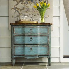 Make an impression with the Accent Console chest by Hooker Furniture. The stunning pop of turquoise with Gold Leaf accents will have all your friends asking where you bought it.