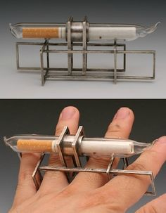 Ring | Liaung-Chung Yen. 'Cages'. Sterling silver, glass and cigarette.