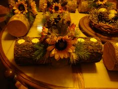 Rustic log center pieces for wedding tables...
