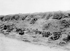WW1, Battle of the Somme. British soldiers in dugouts on a sunken road leading to Contalmaison, July 1916. National Army Museum NAM 2001-01-279-88