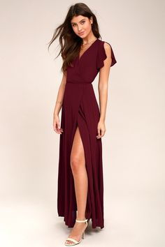 Win them over with the Heart of Marigold Burgundy Wrap Maxi Dress! Burgundy maxi dress with a surplice bodice, short sleeves, and a wrap skirt.