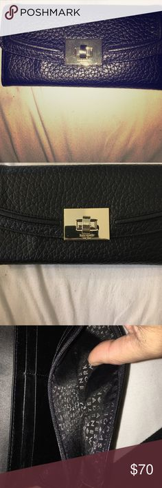 Kate Spade Wallet Black Leather Kate Spade Wallet with gold clasp. Only used a couple of times and is in very good condition. No spots, stains or scratches. 8 credit card slots with coin pouch inside. Also 4 other slots for money, cards etc including a slot on the backside of the Wallet. Very roomy , very classy , very affordable! kate spade Accessories