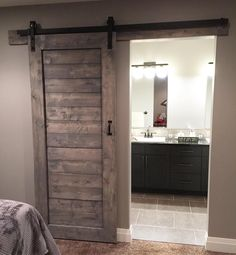 "Timber + Gray Design Co. on Instagram: ""My clients have the most beautiful homes here's a shot of a barn door install from last week / stained in weathered grey"""