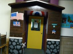 This is another door that I painted.  I had a carpenter create the roof facade and then made it look like wood.  I decorated it for every season of the year.  It was a lot of fun and the kids loved going through a fun door.