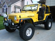 i love jeeps. yellow jeep wrangler with nice tires