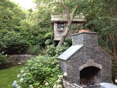 Outdoor fireplace / tree house.