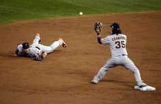 San Francisco Giants second baseman Joe Panik flips to shortstop Brandon Crawford to start a double play against the Kansas City Royals in the third inning