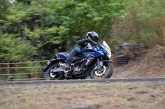 Pulsars AS 150 and 200 aim to be adventure sport bikes. We've just stepped off after quick test rides outside Pune.