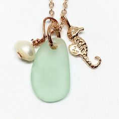 Who loves a little seahorse?! These tiny Sterling Silver or Vermeil charms are just the thing this sea glass necklace needs!!! Each charm necklace comes with a freshwater pearl bead and an 18 chain made of 16k plated gold. Choose between silver/white gold and lavender sea glass or 16k plated yellow