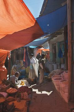 """Harar: """"Serious shoppers can test out their haggling skills with the fabric sellers at the Asian Market, known locally as the cigari market, and then watch as one of the male tailors zips you up a traditional Harari dress (a long kaftan with matching scarf) in a matter of minutes."""" www.bradtguides.com"""