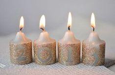 Add some glamour to your December with these Glitzy New Year's Eve Candles. This surprisingly simple tutorial is both affordable and adorable, and helps you make the perfect last minute DIY party decorations for that party tonight! New Year's Eve Crafts, Halloween Crafts For Kids, Craft Projects For Kids, Diy Crafts, Craft Ideas, Glitter Candles, Diy Candles, Pillar Candles, Glitter Rocks