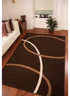 The Rug House Chocolate Brown and Tan Modern Swirl Design Rug 160cm x 230cm (5ft 3`` x 7ft 6``) Thisstriking modern rug is designed with a striking base colourinchocolate brownwith swirls in light brown and cream. Made from 100% Polypropylene this rug is stain r (Barcode EAN = 5055636800482) http://www.comparestoreprices.co.uk/carpets-and-rugs/the-rug-house-chocolate-brown-and-tan-modern-swirl-design-rug-160cm-x-230cm-5ft-3-x-7ft-6-.asp