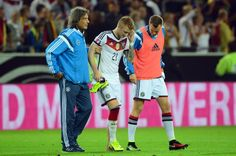 Germany's midfielder Marco Reus (C) is accompanied by the team's doctor Hans-Wilhelm Mueller-Wohlfahrt (L) and Germany's defender Kevin Großkreutz (R) as he leaves the pitch following injury during the UEFA Euro 2016 Group D qualifying match of Germany vs Scotland on September 7, 2014 in Dortmund, western Germany.