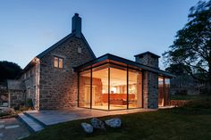 Wide Glass Wall With Fantastic Lamps Decoration As One Of The Modern Extension To The Old Stone House Along With Stone Terrace And Green Court The Modern Extension to the Old Stone House Modern Farmhouse Exterior, Rustic Farmhouse, Urban Farmhouse, Farmhouse Style, Farmhouse Contemporary, Farmhouse Renovation, Contemporary Building, Contemporary Kitchens, Farmhouse Plans