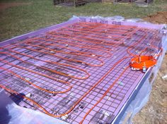 Here's the pex laid in the greenhouse. Hot water from the boiler will pass through these lines to heat the concrete and ultimately the greenhouse. Greenhouse Panels, Large Greenhouse, Build A Greenhouse, Greenhouse Gardening, Greenhouse Ideas, Aquaponics Garden, Heated Greenhouse, Gardening Tips, Underground Greenhouse